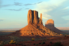 Monument Valley Arizona sunset. Orange-colored butte against morning clouded sky royalty free stock images