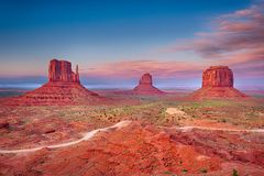 Monument Valley. Beautiful dramatic sunset over the East, West Mitten Butte and Merrick Butte in Monument Valley. Utah, USA Royalty Free Stock Photos