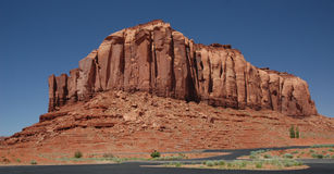 Monument Valley butte in approach area Stock Images