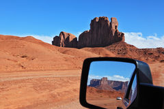 The Monument Valley in the car mirror Royalty Free Stock Photography