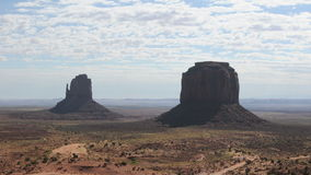 Monument Valley Clouds Time Lapse - Pretty. Time lapse of Monument Valley Arizona.  Shot using a Nikon D300S stock footage