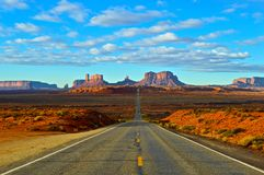 Monument Valley. Dessert Road in fron of the Monument Valley, Utah royalty free stock images
