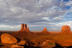 Monument Valley. Famous view of Monument Valley with Mittens and Merrick buttes at sunset Stock Image