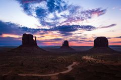 Monument Valley. Famous view of Monument Valley before sunrise with the Mittens and Merrick butte Stock Photos