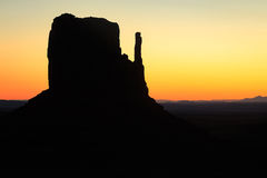 Monument Valley golden sunrise silhouette Royalty Free Stock Images
