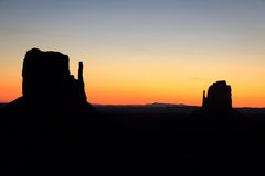 Monument Valley golden sunrise silhouette Stock Photography