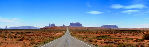 Monument Valley Highway Panorama. Highway road through Rock formations of Monument Valley in Utah and Arizona Royalty Free Stock Images