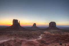 Monument valley holiday destination backlit by sunrise Stock Photography