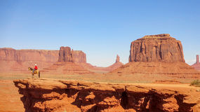 Monument Valley and a horse rider Royalty Free Stock Image