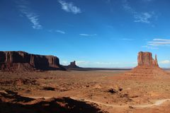 Monument valley landscape with blue sky and some cloud trails. Farwest ambience and wild nature Royalty Free Stock Images