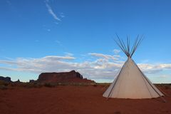 Monument valley landscape with tipi and blue sky royalty free stock photo