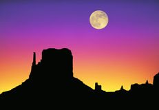 Monument Valley moon sunset. Evocation of Monument Valley skyline at sunset with full moon Stock Photo