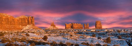 Monument Valley Navajo Indian Park Panorama Sunset. Panoramic sunset scene from the Monument Valley Navajo Indian Reservation Tribal Park in Arizona and Utah Royalty Free Stock Image