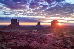 Monument Valley Navajo Tribal Park during sunset, dramatic colorful sky. Sunset time in Monument Valley Navajo Tribal Park, Beautiful West and East Mittens royalty free stock photos