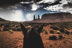 Three sisters, Monument Valley Navajo Tribal Park, dramatic sky, rainy day stock images