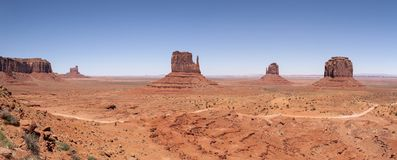 Monument Valley Navajo Tribal Park. World famous red rock buttes surrounded by sandy plains Royalty Free Stock Photography
