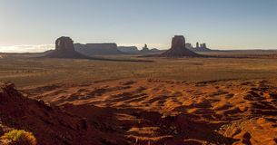 Monument Valley Navajo Tribal Park. World famous red rock buttes surrounded by sandy plains Royalty Free Stock Images