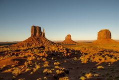 Monument Valley Navajo Tribal Park. World famous red rock buttes surrounded by sandy plains Stock Photography