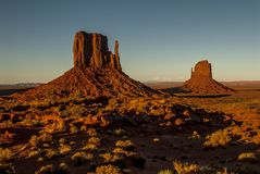 Monument Valley Navajo Tribal Park. World famous red rock buttes surrounded by sandy plains Royalty Free Stock Image