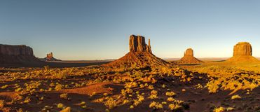 Monument Valley Navajo Tribal Park. World famous red rock buttes surrounded by sandy plains Stock Photos