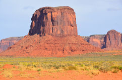 Monument Valley. Is a region of the Colorado Plateau characterized by a cluster of vast sandstone buttes above the valley floor. It is located on the Arizona Royalty Free Stock Photo
