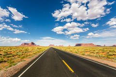 Monument valley road going to the horizon Stock Photo