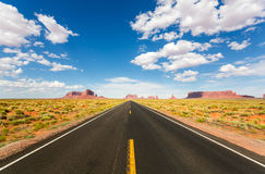 Monument valley road going to the horizon Stock Photography