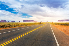 Monument valley road going to the horizon Stock Images