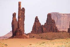Monument Valley Sentinels. Most geologic formations are broad and thick in Monument Valley, except for these sentinel rocks having a pleasing appearance Stock Images