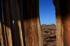 Monument Valley through slats in fence. USA, Monument Valley- Road through slats in fence Royalty Free Stock Image