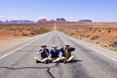 Monument Valley Speak, Hear, See No Evil. Three monkeys sit on a deserted highway in Southern Utah, with their backs to Monument Valley in northern Arizona Stock Photography