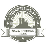 Monument Valley stamp - Navajo Tribal Park. Embelm Royalty Free Stock Photo