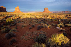 Monument valley at sunset. Two monts of Monument valley at sunset by a stormy day Royalty Free Stock Images