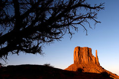 Monument Valley sunset. West Mitten Butte at sunset in the Monument Valley Navajo Tribal Park near Arizona and Utah borderline Stock Photo