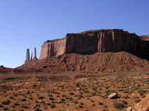 Monument Valley: Three Sisters. On the left are the 'Three Sisters' - one of the rock formations for which Monument Valley Tribal Park is famous Stock Photography