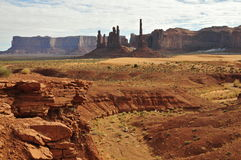 Monument Valley:Totem Poles. Monument Valleys group of Totem Poles; drop-off in the foreground Royalty Free Stock Photos