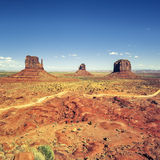 Monument valley under blue sky Stock Photo