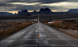 Monument Valley, Utah, an Infinite Road to an Epic Place. A wintery road leads straight to the epic buttes of Monument Valley, an iconic American vista like no Royalty Free Stock Photography