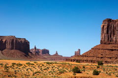 Monument Valley Utah Mesas. Sandstone mesas rise up out of the desert floor in Monument Valley, Utah, a part of the Navajo Indian Reservation Royalty Free Stock Image