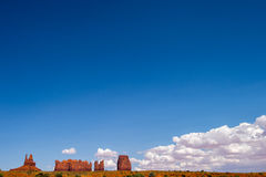 Monument Valley, Utah. Monument Valley Utah with white puffy clouds and lots of Blue Sky Royalty Free Stock Photography
