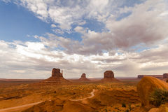 Monument Valley view in the afternoon, cloudy sky Royalty Free Stock Photos