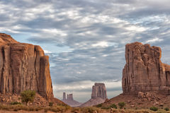 Monument Valley view on cloudy sky background Stock Images