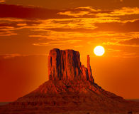 Monument Valley West Mitten at sunrise sky. Monument Valley West Mitten at sunrise sun orange sky Utah photo mount stock image