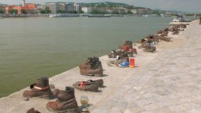 Monument by victims of World War on Pest side of Danube Promenade, shoes on Danube Bank