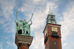 Monument Vikings blowing in Lurs and clock tower Stock Image