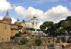Monument of Vittorio Emanuele and Roman Forum, Rome. View of the monument to Vittorio Emanuele from the ruins of famous ancient Roman Forum, Rome, Italy Royalty Free Stock Photography