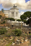 Monument of Vittorio Emanuele and Roman Forum, Rome. View of the monument to Vittorio Emanuele from the ruins of famous ancient Roman Forum, Rome, Italy Stock Images