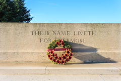Monument world war one with wreath of poppies. Stock Photo