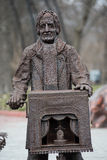 Monument in the zoo in Kiev. Monument to a man with a barrel organ in a zoo in Kiev royalty free stock photography