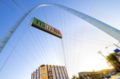 Monumental arch, Tijuana, Mexico. The Millennial Arch (Arco y Reloj Monumental), a metallic steel arch at the entrance of the city of Tijuana in Mexico, at zona Stock Image
